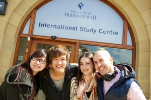 Students Ari Metin, Iana Cushir, Vu Anh Tho and Zhou Fang stand in front of the International Study Centree (ISC) the University of Huddersfield. Huddersfield Testimonial Photoshoot 05-2011.